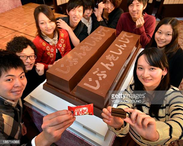 University of Tokyo students display a large sized KitKat chocolate bar measuring 100 x 60 x 20cm and weighing 80kg as they encourage high school...
