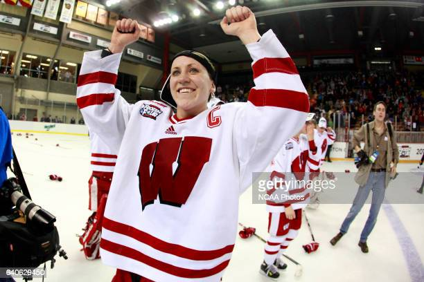 University of Wisconsin Captain Meghan Duggan celebrates their victory over Boston University in the Division I Women's Ice Hockey Championship held...