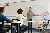 University professor asking to his students in a classroom