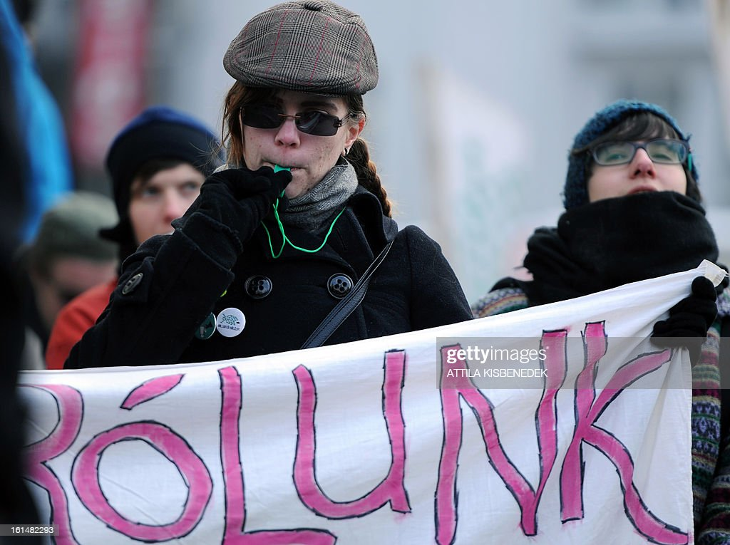 A University student blows her whistle and holding a banner written 'From us' in Budapest's on February 11, 2013 during a demonstration to protest against the Hungarian government's education policy.