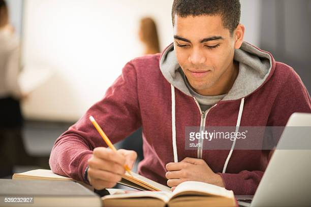 university student checking his notes