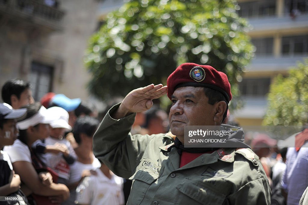 A university student fancy dressed as late Venezuelan President Hugo Chavez participates in the 'Huelga de Todos los Dolores' (Strike of All Sorrows) held every year during Lent in Guatemala, in Guatemala City, on March 22, 2013. Thousands of students got to the streets to take part in the annual parade that satirizes and makes fun of politicians. AFP PHOTO/Johan ORDONEZ