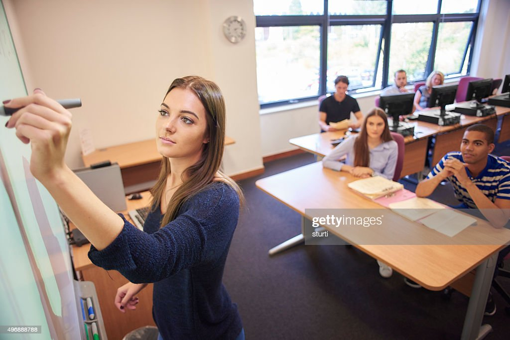 university student presenting to class : Stock Photo