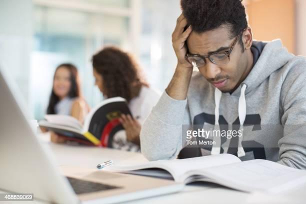 University student reading in classroom
