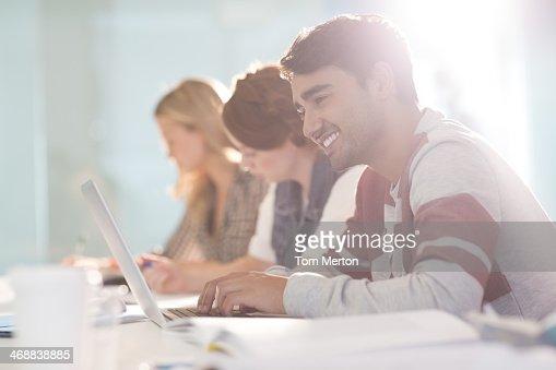 University student using laptop in classroom : Stock Photo
