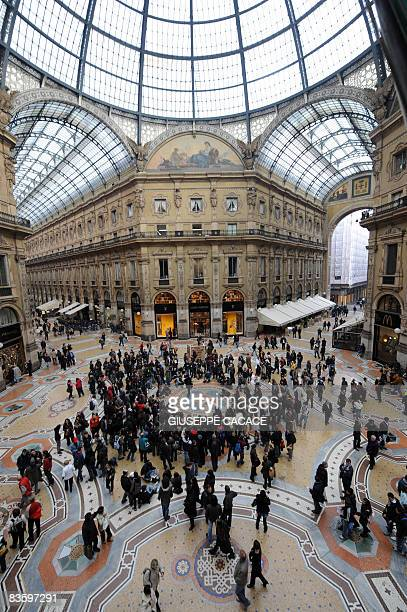 University students attend a public lesson inside the 'Galleria Vittorio Emanuele' to demonstrate against new goverment budget cuts in Milan on...