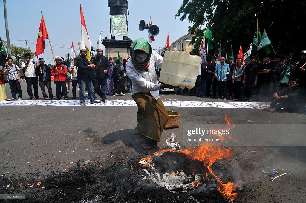 University students burn tires during a protest against government decision that repeal subsidies and raise fuel prices in Surakarta city of Central...