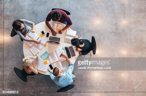 University students doing group study : Stock Photo