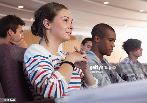 University students listening in lecture hall