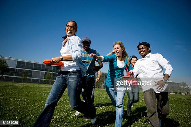 University students playing Frisbee on campus