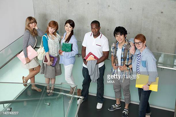 University students standing on stairs