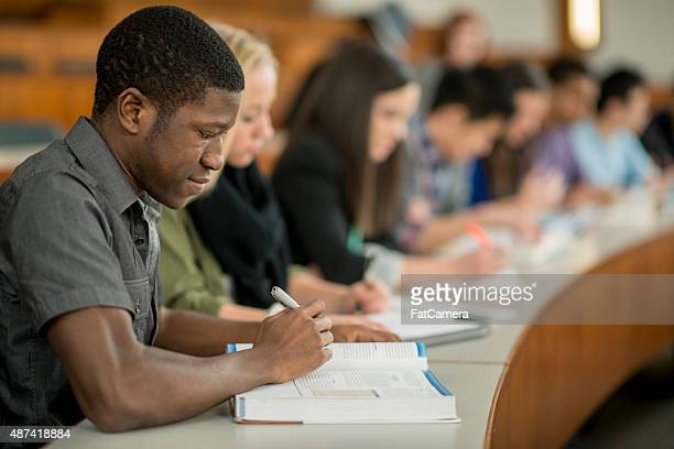 University Students Taking Notes
