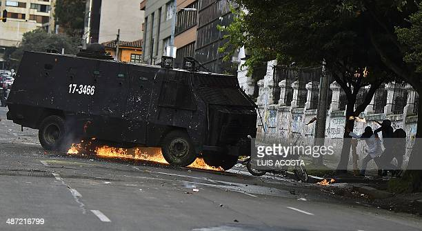 University students throw Molotov cocktails to a riot police truck during the first day of a national strike by farmers protesting against the...