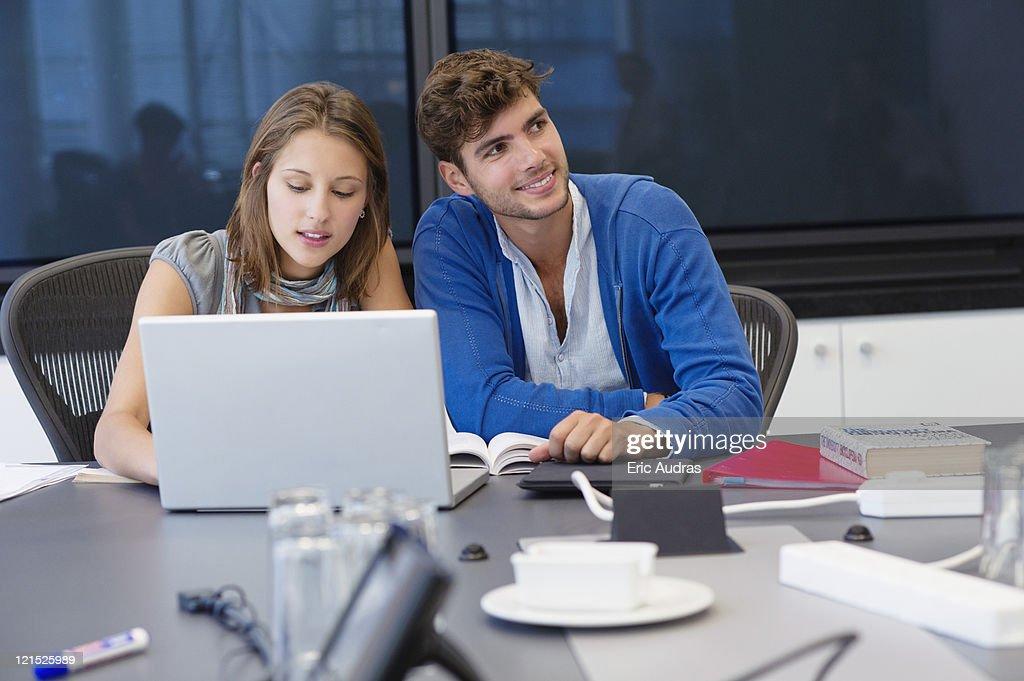 University students using laptop in classroom : Stock Photo