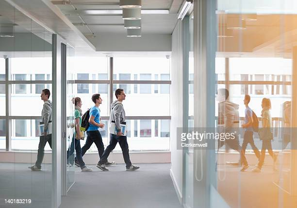 University students walking in corridor