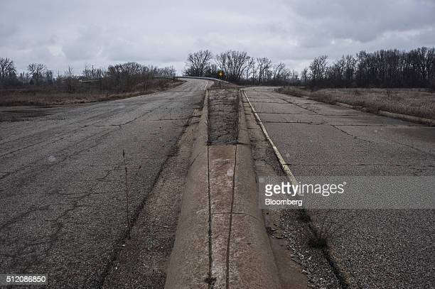 Unkempt roads are seen at the former site of the General Motors Co powertrain plant inside the Willow Run airport in Ypsilanti Michigan US on...