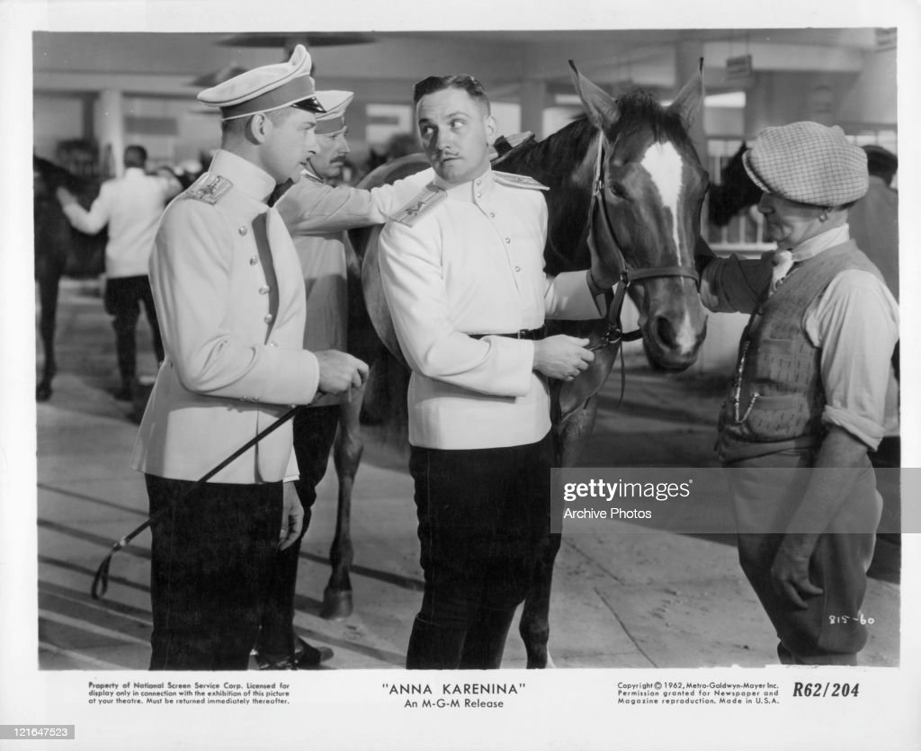Unknown actor and Fredric March in uniform in a scene from the film 'Anna Karenina', 1935.