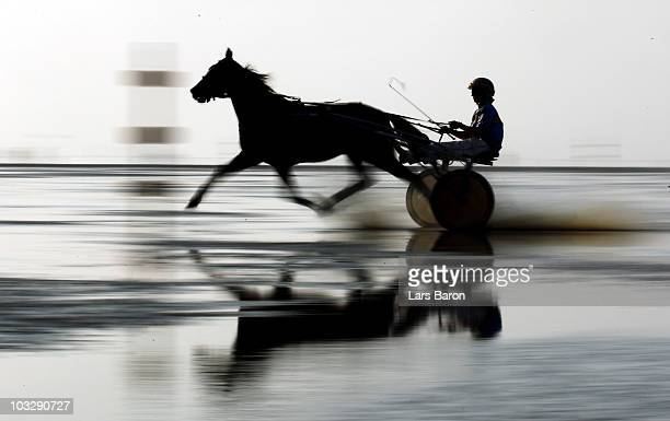 A unknown jockey competes during race eight of the Duhner Wattrennen mudflat race on August 8 2010 in Cuxhaven Germany