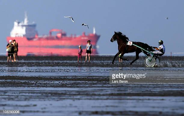 A unknown jockey prepares for the Duhner Wattrennen mudflat race on August 8 2010 in Cuxhaven Germany