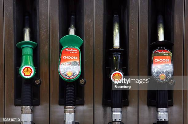 Unleaded and diesel petrol pumps sit holstered at a Royal Dutch Shell Plc gas station in Brentwood UK on Wednesday Jan 20 2016 Shell which is buying...