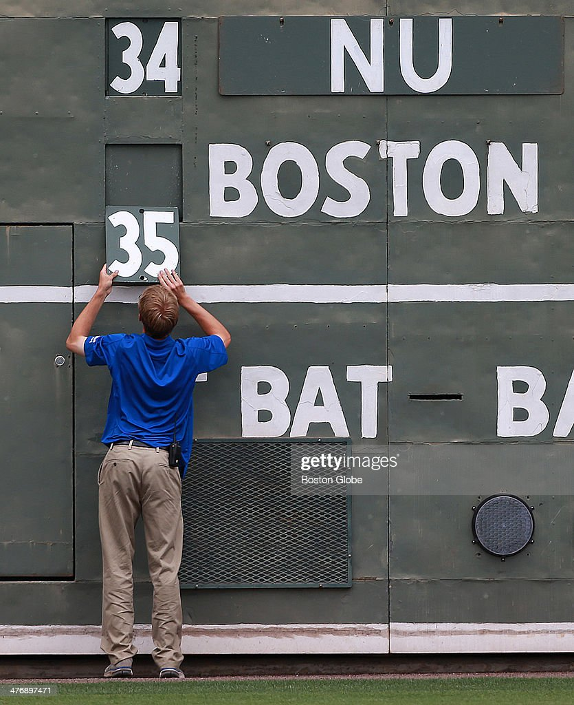 Unlike the Green Monster at Fenway Park, where numbers are changed from behind, the Florida version of the scoreboard requires a worker to update the numbers on the field between innings. The Boston Red Sox played their annual spring season opening double header, with games against Northeastern University and Boston College on Feb. 27, 2014.
