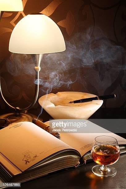 Unlit cigar on a personal organizer