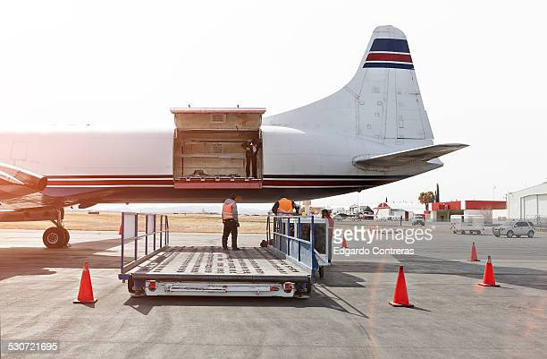 Unloading cargo plane in an airport