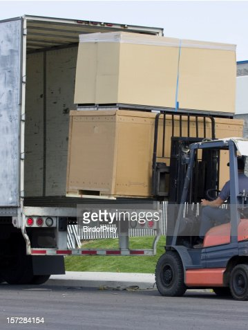Unloading Large Box Crates, with Forklift.