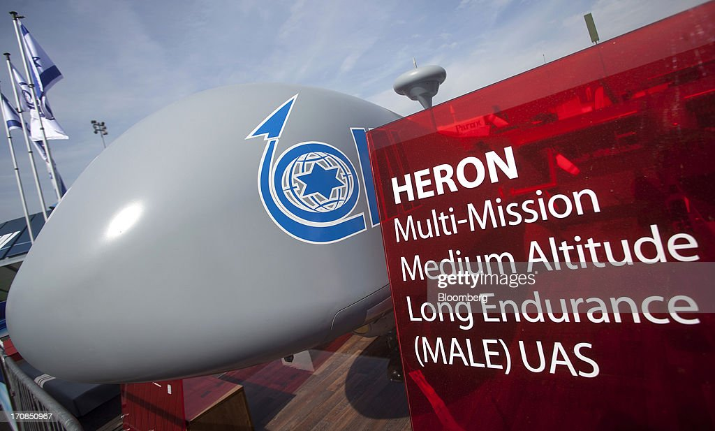 A HERON unmanned air vehicle (UAV) or drone, manufactured by Israel Aerospace Industries Ltd. (IAI), sits on display outside the company's stand on the second day of the Paris Air Show in Paris, France, on Tuesday, June 18, 2013. The 50th International Paris Air Show is the world's largest aviation and space industry show, and takes place at Le Bourget airport June 17-23. Photographer: Balint Porneczi/Bloomberg via Getty Images