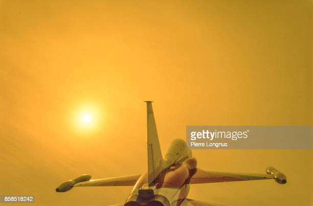 Unmarked decommissioned fighter jet plane. Colorful sky background