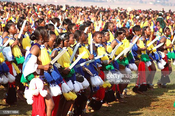 Unmarried women from Swaziland dance for Africa's last absolute monarch King Mswati III at the Ludzidzini Royal Residence near the capital Mbabane on...
