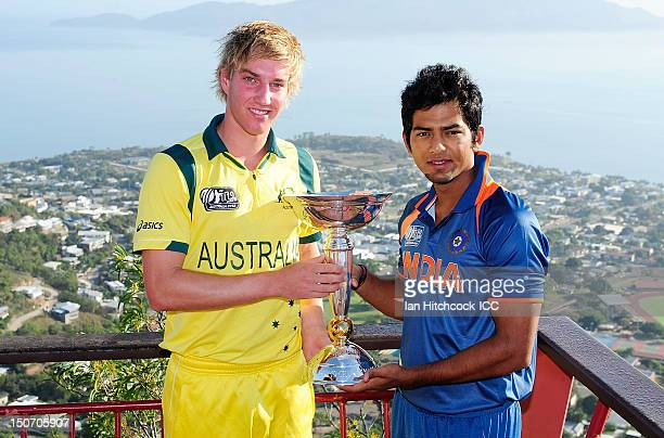 Unmukt Chand of India and William Bosisto of Australia pose with the U19 Cricket World Cup trophy ahead of the 2012 ICC U19 Cricket World Cup Final...