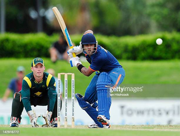 Unmukt Chand of India bats in font of James Peirson of Australia during the match between Australia and India on day five of the U19 International...
