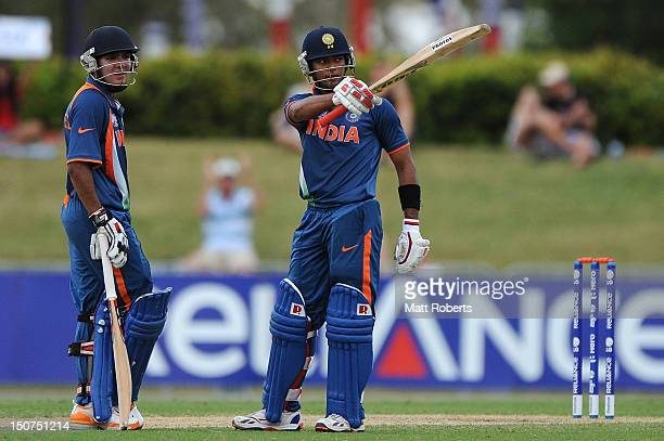 Unmukt Chand of India celebrates reaching his century during the 2012 ICC U19 Cricket World Cup Final between Australia and India at Tony Ireland...