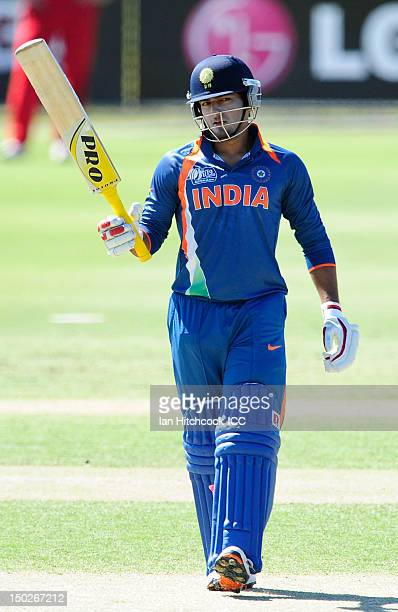 Unmukt Chand of India celebrates scoring a half century during the ICC U19 Cricket World Cup 2012 match between India and Zimbabwe at Tony Ireland...