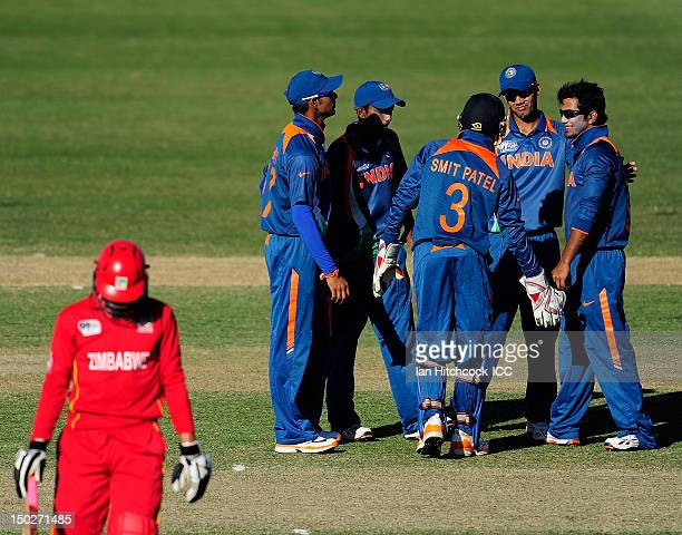 Unmukt Chand of India celebrates with team mates the wicket of Campbell Light of Zimbabwe during the ICC U19 Cricket World Cup 2012 match between...