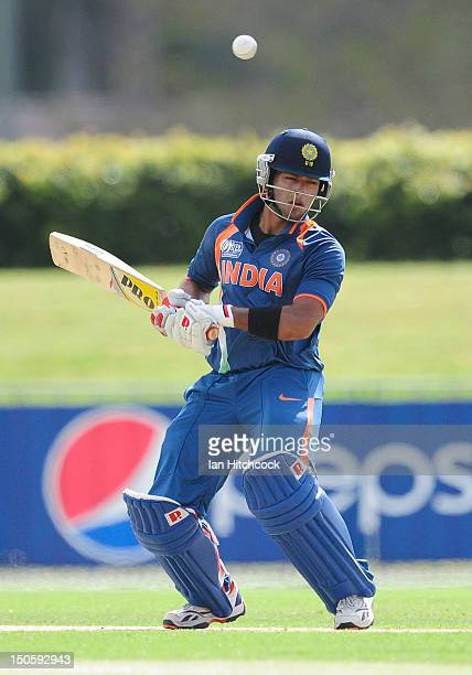 Unmukt Chand of India ducks under a bouncer during the ICC U19 Cricket World Cup 2012 Semi Final match between India and New Zealand at Tony Ireland...