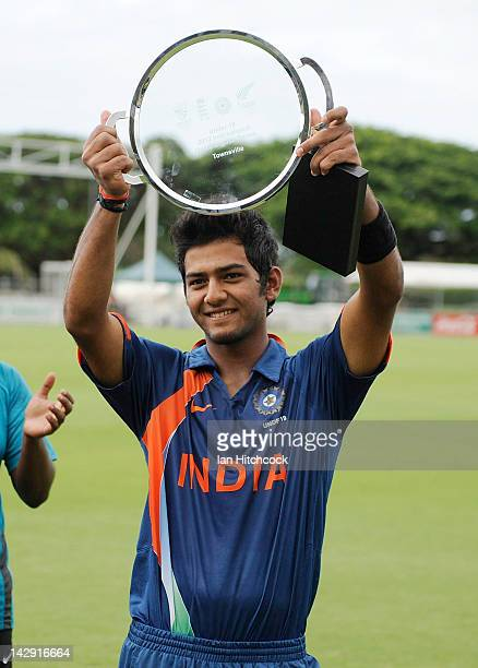 Unmukt Chand of India holds up the tournament trophy after winning the match between Australia and India on day five of the U19 International Quad...