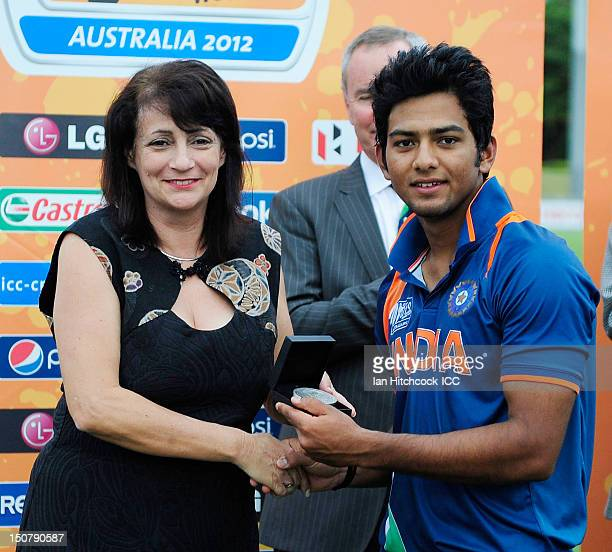 Unmukt Chand of India is presented with the player of the match award during the 2012 ICC U19 Cricket World Cup Final between Australia and India at...