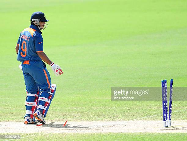 Unmukt Chand of India looks back at the stumps after being bowled during the ICC U19 Cricket World Cup 2012 Semi Final match between India and New...