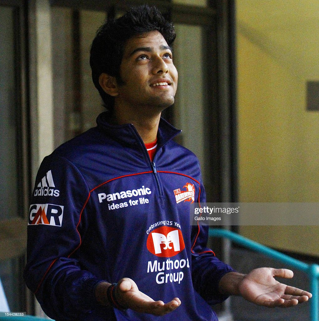 Unmukt Chand of the Delhi Daredevils feels the rain during the CLT20 match between Auckland Aces and Delhi Daredevils from Sahara Stadium Kingsmead on October 19, 2012 in Durban, South Africa.