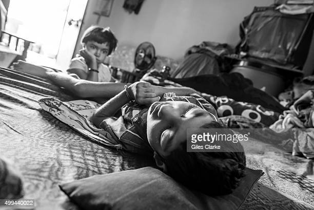 Unnati 6 years old at home with his sister Ishika 4 years old in the Mahamai Ka Bagh neighborhood Unnati was born to parents contaminated by a...