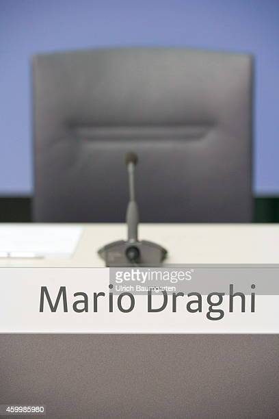Unoccupied Draghi seat microphone and name plate before the beginning of the monthly press conference of the European Central Bank in Frankfurt on...