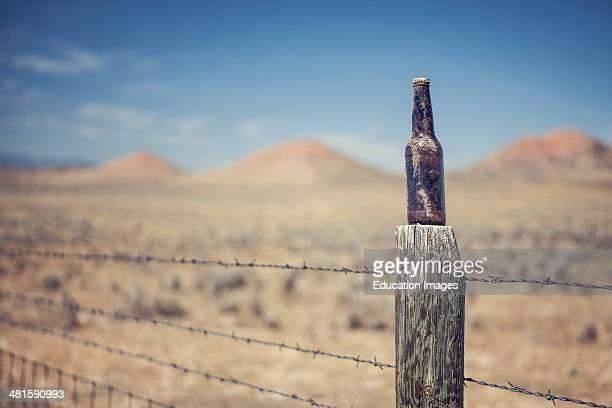 Unopened beer bottle on fence post near Buffalo Wyoming