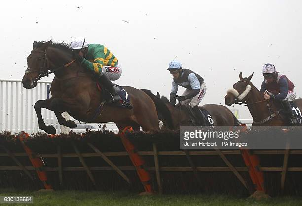 Unowhatimeanharry ridden by Barry Geraghty clears an early flight before going on to win The JLT Long Walk Hurdle Race run during day two of the...