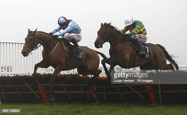 Unowhatimeanharry ridden by Barry Geraghty clears the last flight in company with Ballyoptic idden by Richard Johnson before going on to win The JLT...