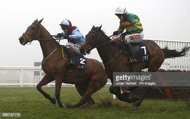 Unowhatimeanharry ridden by Barry Geraghty clears the last flight in company with Ballyoptic ridden by Richard Johnson before going on to win The JLT...