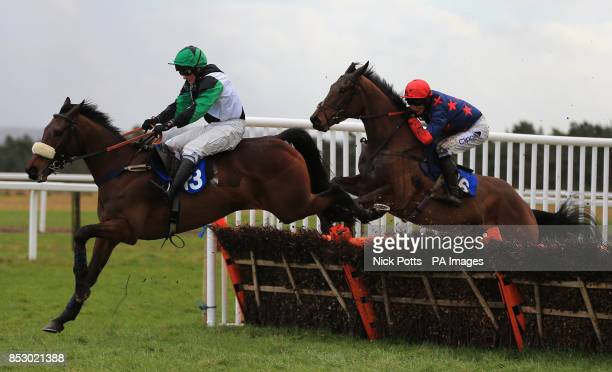 Unowhatimeanharry ridden by jockey Paul Moloney jumps the final fence with Dormello riden by Daryl Jacob during The Barthwick Tythe Bathwick Tyres...