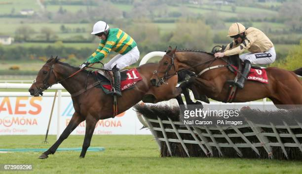 Unowhatimeanharry ridden by Noel Fehily goes on to win The Ladbrokes Champion Stayers Hurdle ahead of Nichols Canyon ridden by Ruiby Walsh during day...