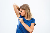 Young woman is sweating to much and she doesn't like her smell under armpit.